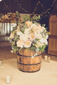 Bevy Of Ivory Blooms In Rustic Barrel