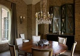 Modern French Dining Room Design With Rustic Exposed Brick Walls Grey Velvet Drapes Black Mirrored X Cabinets Hutch Cherry Pedestal Table