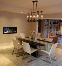 View In Gallery Chandelier Above The Dining Table Complements Fireplace Stylishly