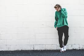 Womens Green Knit Oversized Sweater Black Sweatpants White And Athletic Shoes