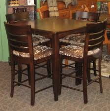 Vienna Pub Table With Chairs Shown In Brown Maple A Rich Tobacco Finish