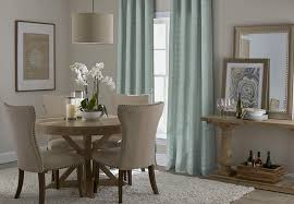 Dining Room With Patterned Curtains
