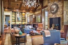 rustic living room with hardwood floors cement fireplace in vail
