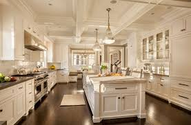 traditional kitchen with limestone tile by garrison hullinger