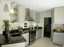 Kitchen White Wooden Cabinet Having Black Countertop On Ceramics Flooring And Wall Awesome Schemes Of Fitted Kitchens For Small Spaces With Contemporary