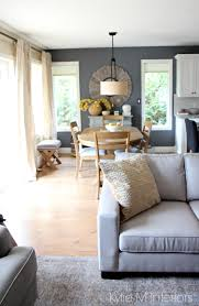 Modern Country Or Farmhouse Style Open Concept Dining Room And Living With Gray Warm Gold Yellow Accents Couch Rug Paint Color All