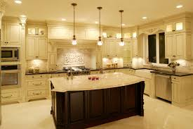 Luxurious Kitchen Awash In Light Marble Tones Dominated By Large Dark Wood Island With Filigreed