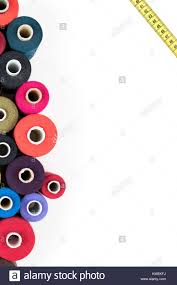 Colored thread coils isolated on white background sewing supplies