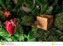 Close Up Image Of Artificial Christmas Tree With Small Red And Golden Decorative Boxes On It