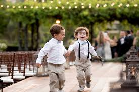 Two Ring Bearers Play Together Before The Ceremony