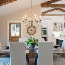 Refined Dining Room With Vaulted Exposed Beam Ceilings