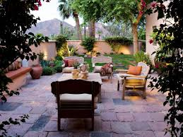 Stucco Walls Lend Privacy To This Arizona Backyard Rustic Stone Pavers Define A Cozy Outdoor