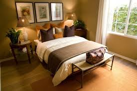Again Utilizing Decorative Pillows In Place Of A Headboard This Brown And Orange Bedroom Makes