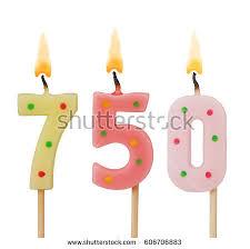 Burning birthday candles isolated on white background number 750