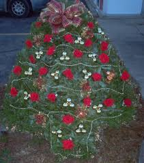 Christmas Tree With Red Flowers Gold Bulbs And Garland Graveside DecorationsCemetery