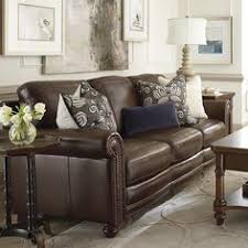 Dark Brown Couch Living Room Ideas by Brown Leather Sofa Set For Living Room With Dark Hardwood Floors