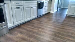 coretec waterfront oak luxury vinyl plank in kitchen degraaf