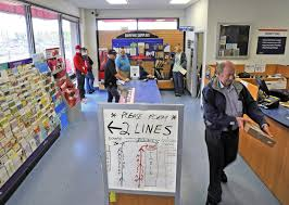 Medford residents plain about long passport lines at post