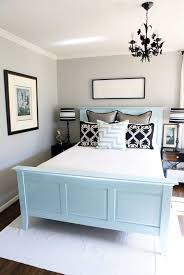 small bedroom using black chandelier blue bed frame and light