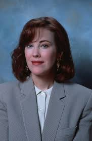 Catherine O Hara wallpaper with a business suit a suit and a double