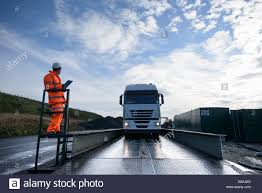 Worker Directing Truck On Scales Stock Photo: 53094453 - Alamy Natsn New Transit Truck Stop How To Weigh Your Rv On A Cat Scale Youtube About Scales Center Of Arizona Weighing In Digital Nicholas Gerbis Near Me Public Survivor Otr Steel Deck Works Loadritcales Weighbridge Max 135 T Eprc Series Cardinal Videos Strathroy Ontario Inc Service And Sales Revell 124 Roumaster Bus Model Model Vehicles Pinterest Automation Software Payload Pro Toledo Carolina