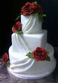 """The Cupcake Wedding Cake Guests are able to have their own """"cake"""" to themselves and the bride and groom are still able to keep their top tier"""