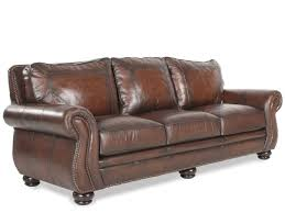 mathis brothers sofa and loveseats nailhead accented leather 100 sofa in brown mathis brothers