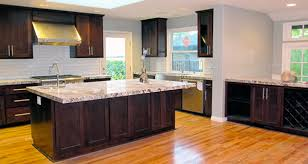Kitchens With Dark Cabinets And Light Countertops by Alaska White Granite