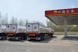 100 Natural Gas Trucks Oil Tanker With Beside A Station Stock Photo