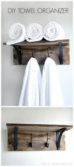 Bathrooms : Kitchen Towel Rack Ideas Diy Towel Rack Ideas Bathroom ... Hanger Storage Paper Bathro Ideas Stainless Towel Electric Hooks 42 Bathroom Hacks Thatll Help You Get Ready Faster Racks Tips Cr Laurence Shower Door Bar Doors Rack Diy Decor For Teens Best Creative Reclaimed Wood Bath Art And Idea Driftwood Rustic Bathroom Decor Beach House Mirrored Made With Dollar Tree Materials Incredible Hand Holder Intended Property Gorgeous Small Warmer Bunnings Target Height Style Combo 15 Holders To Spruce Up Your One Crazy 7 Solutions Towels Toilet Hgtv