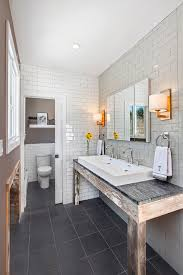 frameless mirror in bathroom rustic with two different wood floor