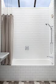 bevelled subway tile with vintage tub bathroom transitional and