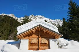 100 Log Cabins Switzerland Snow Covered Log Cabin With A Mountain Range In The Background San Bernardino Grisons Stock Photo