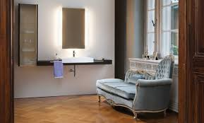 lighted recessed medicine cabinet with laminated wood floor and