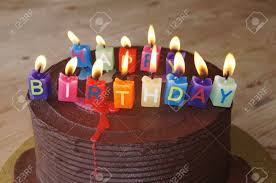 Chocolate cake with happy birthday candles Stock