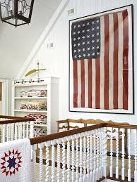 Heirloom Quilts Are Stacked Alongside A 36 Star Flag And Antique Pine Bench On This
