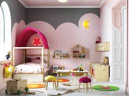 A Large Childrens Bedroom Furnished With Pine Bed Posts And Pink Canopy