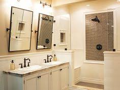 dreamy ensuite bath features gray green paint and white beadboard