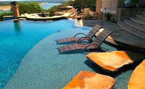 Sun Shelf Chairs In Water Pool Lounge And Beautiful View