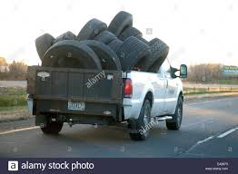 Pickup Truck Filled With Large Truck Tires Driving On The Freeway ... Heavy Truck Tires Slc 8016270688 Commercial Mobile Tire Bigtex Offroad Kingwood Tx And Auto Repair Shop Amazoncom Spare Carrier For Pick Up Trucksfree Shipping Car Jeep Wrangler Goodyear And Rubber Company Tread Pickup Custom Wheels Rapid City Tyrrell With Is It Possible That Chevy Finally Gets With Their 2019 Lifted Dually Trucks In Lewisville 2007 Dodge Ram 1500 Size 2010 Sizes For Flordelamarfilm Rvnet Open Roads Forum Whose Running Michelin Defender Ltx Ms 11r245 Brand Aeolus Goodmmaxietriaelilong Hennessey Unveils 2017 Velociraptor 66 Medium Duty Work West Coast Center Provides Premium Auto Services