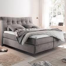 graues boxspringbett mit hochwertigen gestell aus