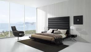 Black Leather Headboard Double by Large Glass Window Without Curtain Facing Black Recliner Near