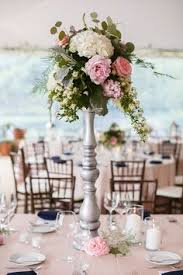 opulent ivory and blush wedding flowers tall centrepieces Silver