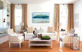 Formal Living Room Furniture Layout by Brown Curtains On The Hook And Beige Cushions On White Sofa
