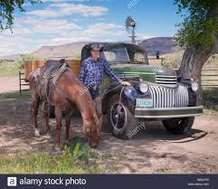 100 Cowboy Truck Standing Near Old Antique Truck With Horse Stock Photo