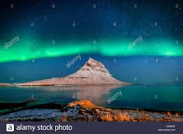 Aurora Borealis or Northern lights with the Milky Way Galaxy Mt