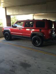 2012 Lifted Jeep Patriot With Painted Gas Tank Cover And Fender ...
