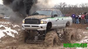 BIG MUD TRUCKS BATTLE!! DODGE VS CHEVY!!! - YouTube