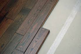 Engineered Flooring Is Actually A Layered Material Only The Top Layer Of Solid Wood While Rest Underneath Criss Cross