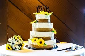 Buttercream Wedding Cake With Burlap Ribbon Personalized Topper And Faux Sunflowers